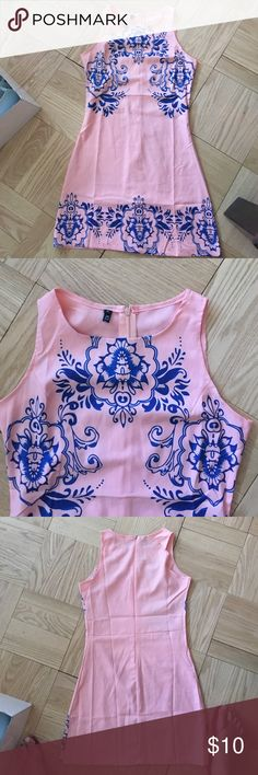 Floral pattern pink and blue summer dress Floral pattern pink and blue summer dress. Zipper back. Tiny tiny snag (pictured). I can't see it unless I'm an inch away from it inspecting it. Other than that great condition. Elfin Dresses Mini