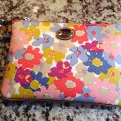 • COACH • wristlet • Brand new. Never worn. Coach Bags Clutches & Wristlets