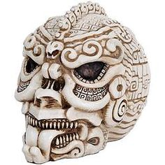 Hauntingly detailed skull features Aztec-inspired artwork and carvings, lending a ghastly air to a skull collection, or the dinner table where your dinner guests will surely be struck silent by its profane beauty.