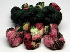 "Full Bloom - Set of Four Jig Monkey Mini Skeins - 20g/93 yards each - 80g/372 yards total Deep in the rose garden - dark green semi-solid with roses all around in pinks from bashful to blush to brazen. This set coordinates with ""Rose Garden"" mini skein set. Jig Monkey Yarn Base - 75% Superwash Merino/25% Nylon 20g/93 yards/mini skein Soft, elastic and durable; a gorgeous sock yarn. Hand Wash ~ Air Dry Want to add a little stripe to your project? Working a sock yarn blanket? Making a master…"