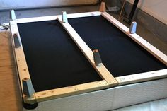 Add boards to bottom of box spring, cover in fabric, and add some legs for a new bed frame to update room