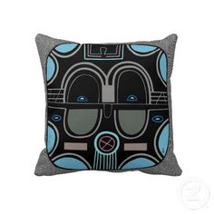 """African Pop (Square) pillow - What do you get when you take a traditional African Tribal Mask & paint it w/ the latest colors for spring 2013 (colors that were also popular in the late 1950's early 1960's)? This fun """"African Pop"""" design as reimagined by digital artist, Leslie Sigal Javorek. Black, medium blue, aqua, mauve, pinkish-gray & olive gray against a faux gray canvas background. See all pillows designed by Leslie only @ www.zazzle.com/homearts/pillows?rf=238155573613991097"""