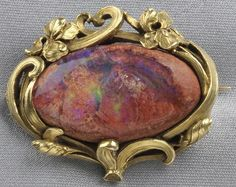 Art Nouveau 14kt gold and matrix opal brooch, the large opal cabochon  framed by irises
