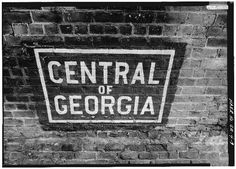 'Central of Georgia' sign painted on the underside of arch spanning West Boundary Street. - Central of Georgia Railway, 1860 Brick Arch Viaduct, Spanning West Boundary Street & Savannah-Ogeechee Canal, Savannah, Chatham County, GA. #trains #Savannah #Georgia