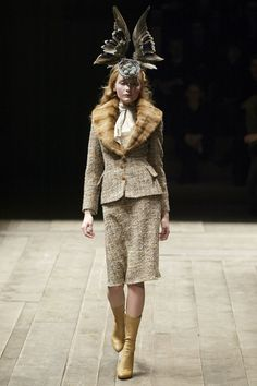 Alexander McQueen, Fall 2006 Even if this hadn't been my first Alexander McQueen show, it would probably still qualify as my favorite. The natty, nipped tweeds; the hourglass tartans; the feathered headdresses . . . By the time Kate Moss emerged in hologram form, I wasn't the only one crying.