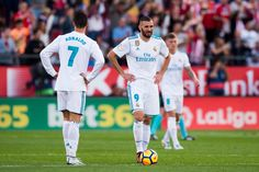 Cristiano Ronaldo Photos - Karim Benzema and Cristiano Ronaldo of Real Madrid CF react after Cristian 'Portu' of Girona FC scored his team's second goal during the La Liga match between Girona and Real Madrid at Estadi de Montilivi on October 29, 2017 in Girona, Spain. - Girona v Real Madrid - La Liga