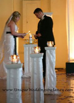 Unity Candle: If you have pillars and aren't sure exactly what to use them for, consider this idea. Votive candles in lovely glass bowls/cups leading up to the unity candle.