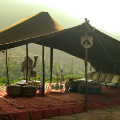 A magical walled complex near Asni in the High Atlas, Kasbah Tamadot is all peaceful courtyards, intriguing staircases, landscaped gardens and breathtaking views. Outdoor Cafe, Outdoor Living, Outdoor Decor, Glamping, Cabana, Bedouin Tent, Cabin Tent, Moorish, Architecture