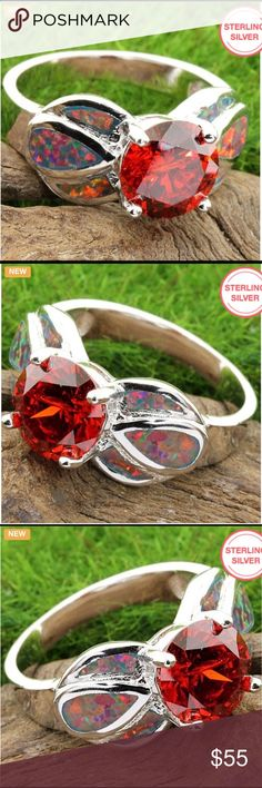 Genuine Red Sapphire This gorgeous ring has 6.80ctw of genuine red Sapphire and (created red fire Opal) on the shanks and is crafted in solid.925 Sterling Silver with 18k white gold overlay Jewelry Rings