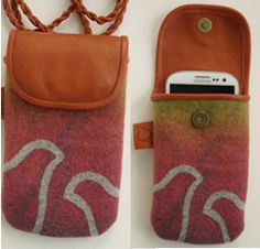 """Smartphone bag to hang around  your neck. It´s made in reindeer leather,  with hand-printed decoration """"Giron"""" on wool.   www.ateljenord.com"""