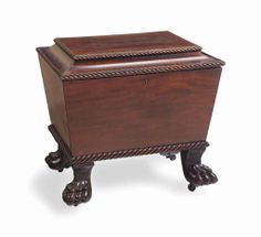 """I love the feet, I love the scrollwork, I love that it is still totally functional. I used it as a side table loaded with art books."" - Joan Rivers. Picture of a regency mahogany cellarette, early 19th century"