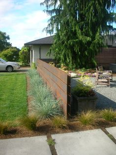 The entry patio is enhanced by containe. Modern Front Yard, Front Yard Design, Front Yard Fence, Modern Fence, Fence Design, Garden Design, Modern Landscaping, Outdoor Landscaping, Front Yard Landscaping