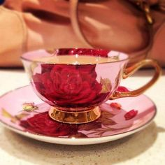 Pink tea cup/ saucer decoreted with red roses and gold,very lovely