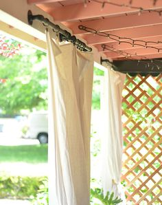 Shavonda Gardner of SG Style hung these DIY outdoor curtains and pipe curtain rods on her patio to soften the look of the space. They add a little extra privacy, too. See more of her boho-style patio makeover on The Home Depot Blog. || @SG_Style