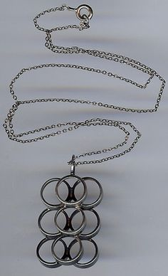 """This vintage sterling silver nine overlapping rings modernist necklace is signed 925 FINLAND HKH and has the polar bear hallmark for Kultaseppa Salovaara Ky. The pendant measures approximately 1-9/16"""" by 7/8"""""""