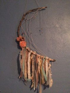 """My DIY half moon dream catcher for baby B's nursery! Approximate time, 2 hours. Materials: tree branch, string, beads, 3 feathers, various lace and ribbons, accent arrow, and flowers. All items (except the stick which I plucked off a tree in my back yard) were purchased at Joann fabrics. Most of the lace came from the """"by the yard"""" scrap bin!!"""