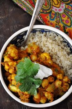 Spicy Morocccan Chickpeas with Quinoa Serves 4-6 1c quinoa 1 1/4 c water Chickpeas 2 T extra-virgin olive oil 1 large yellow onion 2 t ground cumin 1 t ground coriander 1 t ground turmeric 3/4 t cayenne pepper 3/4 t cinnamon 1 T fresh ginger 2 garlic cloves 1 stalk celery 3 c cauliflower florets 3 c cooked chickpeas (or two 15 oz cans) 14 oz can crushed tomatoes 1 c vegetable broth 1/2 c parsley 1 c cilantro juice of 1 lemon