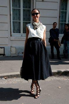 Not just your classic white shirt/black skirt combo. It's not just the sheer volume of this black skirt we love, it's the pure drama of it. Pair something similar with a sleeveless white shirt (buttoned all the way up, naturally) and a heavy necklace.
