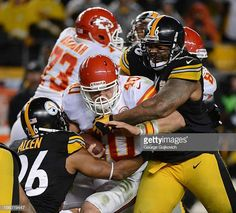 a119a47f48d Linebacker LaMarr Woodley and safety Will Allen of the Pittsburgh Steelers  tackle running back Peyton Hillis