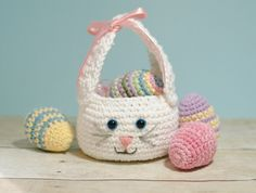 A darling little bunny basket to fill with Easter treats! This Easter bunny basket crochet pattern is quick and simple to work up and features long bunny ears that double as a handle. Get the FREE pattern here ... #crochet #fiber