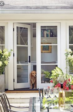 """The Patio Doors Open Up the Exterior - A Dramatic Ranch House Renovation - Southernliving. """"Ranches tend to have ceilings and not a lot of natural light, making them feel cramped,"""" Evans notes. Architecture Renovation, Pavillion, Front Door Makeover, Exterior Makeover, Ranch Remodel, French Doors Patio, French Patio, Farmhouse Patio Doors, French Farmhouse"""