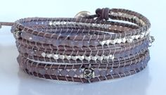This Three Wrap Bracelet has Tiny Sterling Silver Skulls (3.5 mm) ,Smokey Grey Opal Rondelles (3mm) Beads