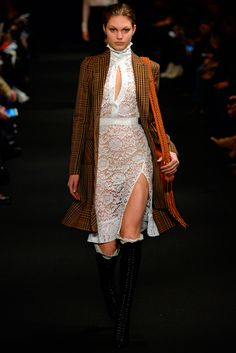 Altuzarra Fall 2015 ready to wear had a variety of influences from the past that can be recognizable through out this collection. In particular this look with the white lace dress and high collar reminded me of 1908 Battenberg lace. The high neckline reminded me of the Victorian period as well. The silhouette of the dress with the slit is more modernized. 4/6/15