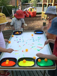 Painting with straws and ping pong balls