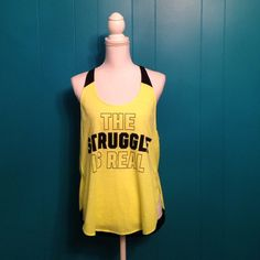 """NWOT PINK graphic tank Brand new neon yellow VS PINK """"The Struggle Is Real"""" graphic on the front. Back has black strip at the bottom with """"PINK PINK PINK"""" graphic on it. Racer back, elongated arm holes and split sides. Curved bottom. No trades. PINK Victoria's Secret Tops Tank Tops"""