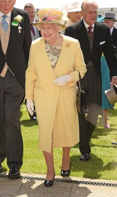 Summery in yellow: Queen Elizabeth II and Prince Philip, the Duke of Edinburgh, attend Derby Day during the Investec Derby Festival at Epsom Racecourse