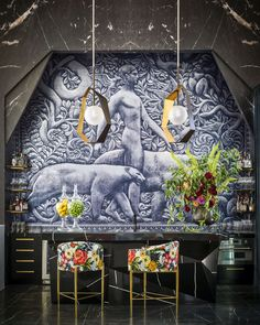 There Are 4 Insanely Cool Kitchens—and a Pink Pantry Full of Fine China!—in This Dallas Home - Cocktail bar with an Art Déco inspired mural in a restored warehouse in Dallas, TX designed by Mic -