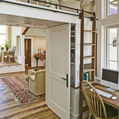 Built in loft above door opening with rolling ladder access