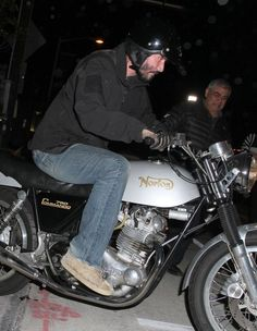 Keanu Reeves is spotted hopping onto his motorcycle and riding off in West Hollywood, California on March 28, 2013.