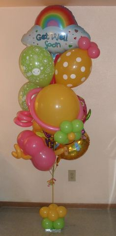 Relax you're over the rainbow get well soon small balloon bouquet $80.