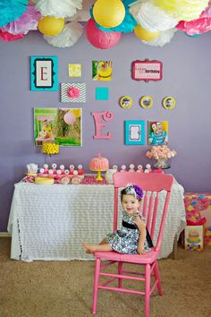 Emily's First Birthday on a very tight budget  Theme-Owls, but more focused on the colors pink, purple, aqua and yellow
