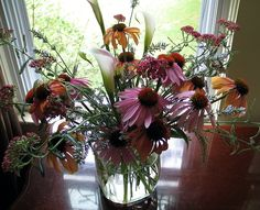 An early summer bouquet from my garden - coneflowers, yarrow and calla lilies.  I especially love these colors, and hopefully soon, I'll be trying torch-fired enamels to recreate them in my jewelry.