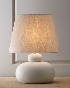 """""""Wyatt Clay"""" Porcelain Table Lamp by Arteriors at Horchow.  $207  Handcrafted porcelain table lamp lends an organic feel to your decor with its look of molded clay complemented by a natural-hued linen shade.  Three-way switch; uses one 150-watt bulb.  16.5""""W x 11""""D x 22.5""""T.  Imported."""