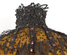 Pingat beaded lace cape, silk satin and black tulle, c.1875-1885. Both the bright orange base and the glittering red beads are blackened