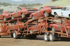 Car Hauler full of 69 Dodge Chargers dressed up as General Lee from Dukes of Hazzard TV set General Lee Car, Hot Wheels, Gp F1, 1969 Dodge Charger, Car Carrier, Dodge Chrysler, Transporter, Us Cars, American Muscle Cars