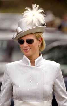 Zara Phillips, daughter of Princess Anne and the Queen's granddaughter arrives for Ladies Day at Royal Ascot in a grey straw hat with white feathers  Sion Touhig/Getty Images
