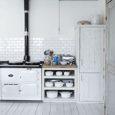subway tile, white le creuset, and white floors. I think I may have a kitchen twin