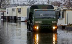 A National Guard vehicle drives through the flooded Metropolitan Trailer Park in Moonachie, N.J., Tuesday, Oct. 30, 2012, in the wake of superstorm Sandy. Sandy arrived along the East Coast and morphed into a huge and problematic system, putting more than 7.5 million homes and businesses in the dark and causing a number of deaths. (AP Photo/Craig Ruttle)