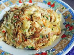 Chinese Omelette is a dish prepared with beaten eggs and add with various vegetables such as carrot, onion and spring onions. I like this dish. It is like an all-in-one dish!