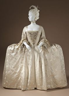 Woman's robe à la française, England, circa 1765. Silk satin with weft-float patterning and silk passementerie.