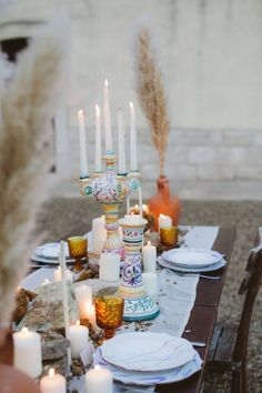 Perfect boho table with pampas, dried flowers, stones and colorful Italian ceramics