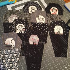 "Working on a full graveyard of #Ghastlies! @wendybzquilting and I enlarged the #ringofcoffins pattern by @jessee_artschooldropout to approx 8"" high, and I'm making a huuuuge ring of them. I'll be ready for Halloween this year! #halloweenquilt"