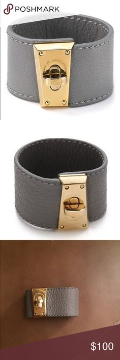 """Marc Jacobs  intergalocktic leather bracelet Super cute great deal   marc by marc jacobs Intergalocktic turnlock bracelet  cosmic grey and gold . fits up to a 7"""" wrist size. rare & fab marc! Purchased at Bloomingdales for $148 retail.  Defect: scratches on turnlock areas as seen they are very minor color of bracelet is grey leather and gold Marc Jacobs Accessories Watches"""