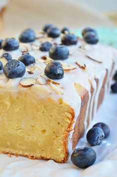 A perfectly moist and lemony gluten free lemon pound cake drizzled with a sweet vanilla glaze and topped with almonds and fresh blueberries.