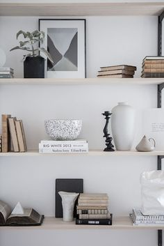 I'm a big fan of this fresh home with different tints of grey. The space has a very clean look, but at the same time looks very inviting as well. My favorite is the grey/beige kitchen with the white m