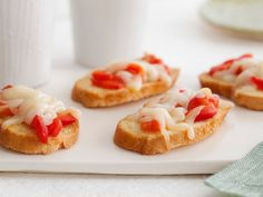 Sweet Pepper Crostini from FoodNetwork.com  Note: rub toasted bread with garlic, fontina cheese and pesto are other suggested additions
